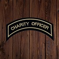 Charity Officer in Tan