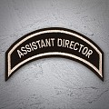 ASSISTANT DIRECTOR Patch Tan